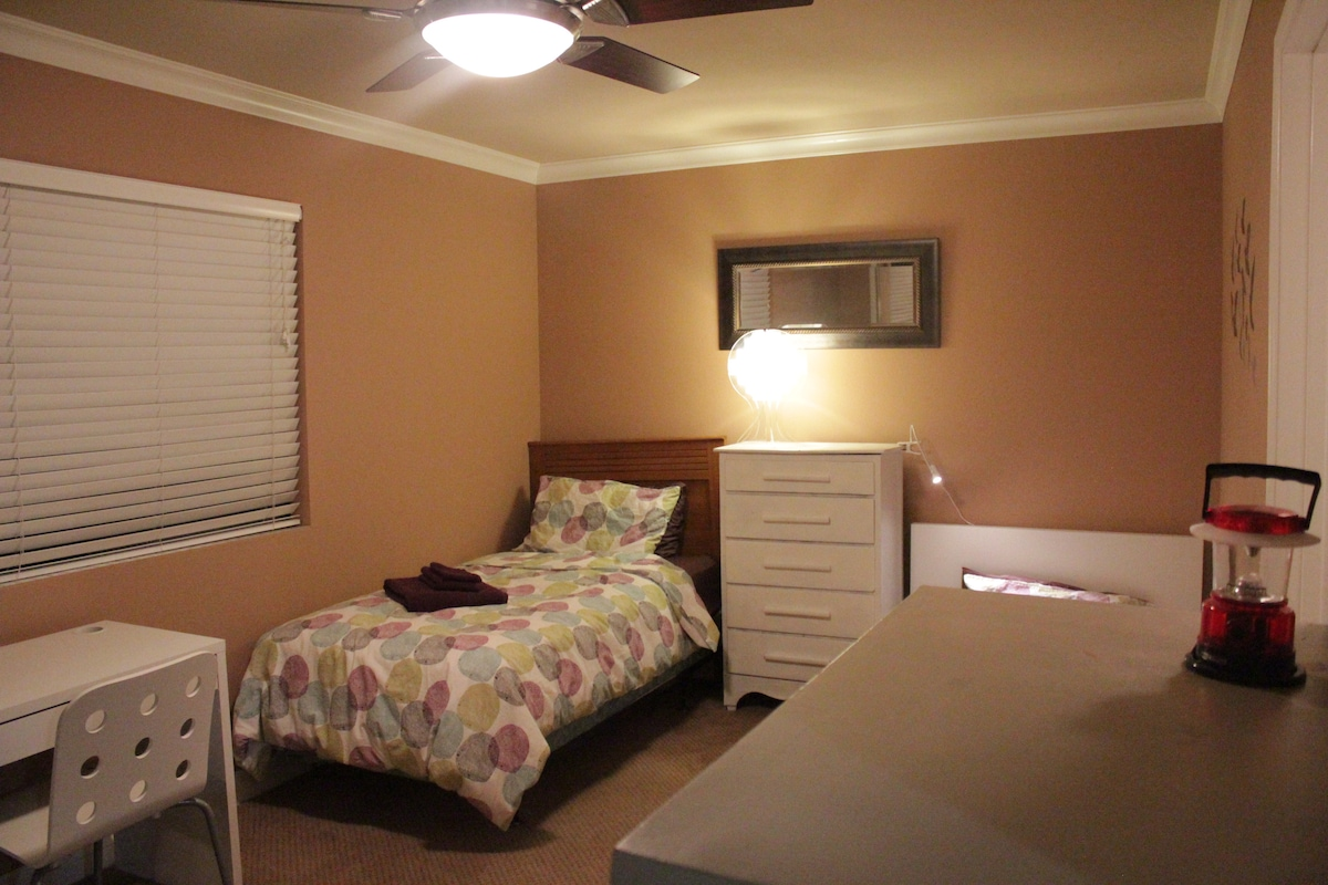 Twin bed by window