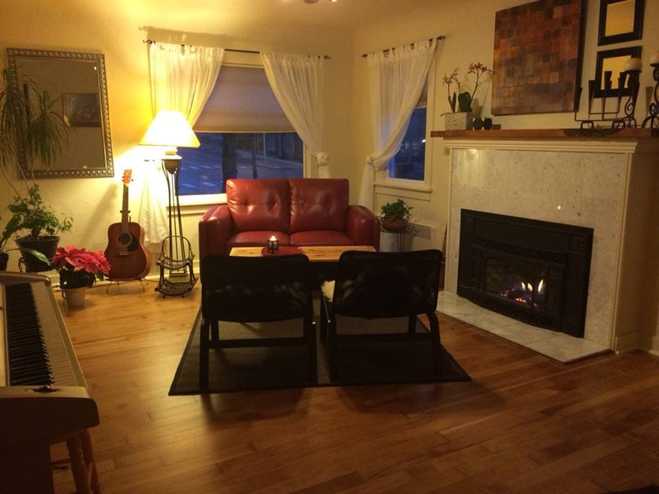 This common room is filled with musical instruments and has a toasty gas fireplace.