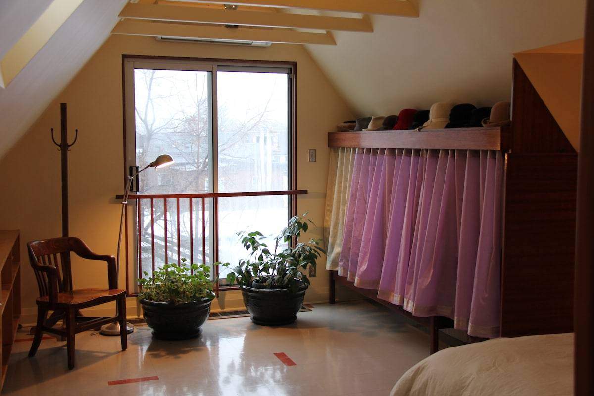Skylights and sliding glass doors fill the room with light all thorough the day.  Additional single bed and closet behind the curtain.