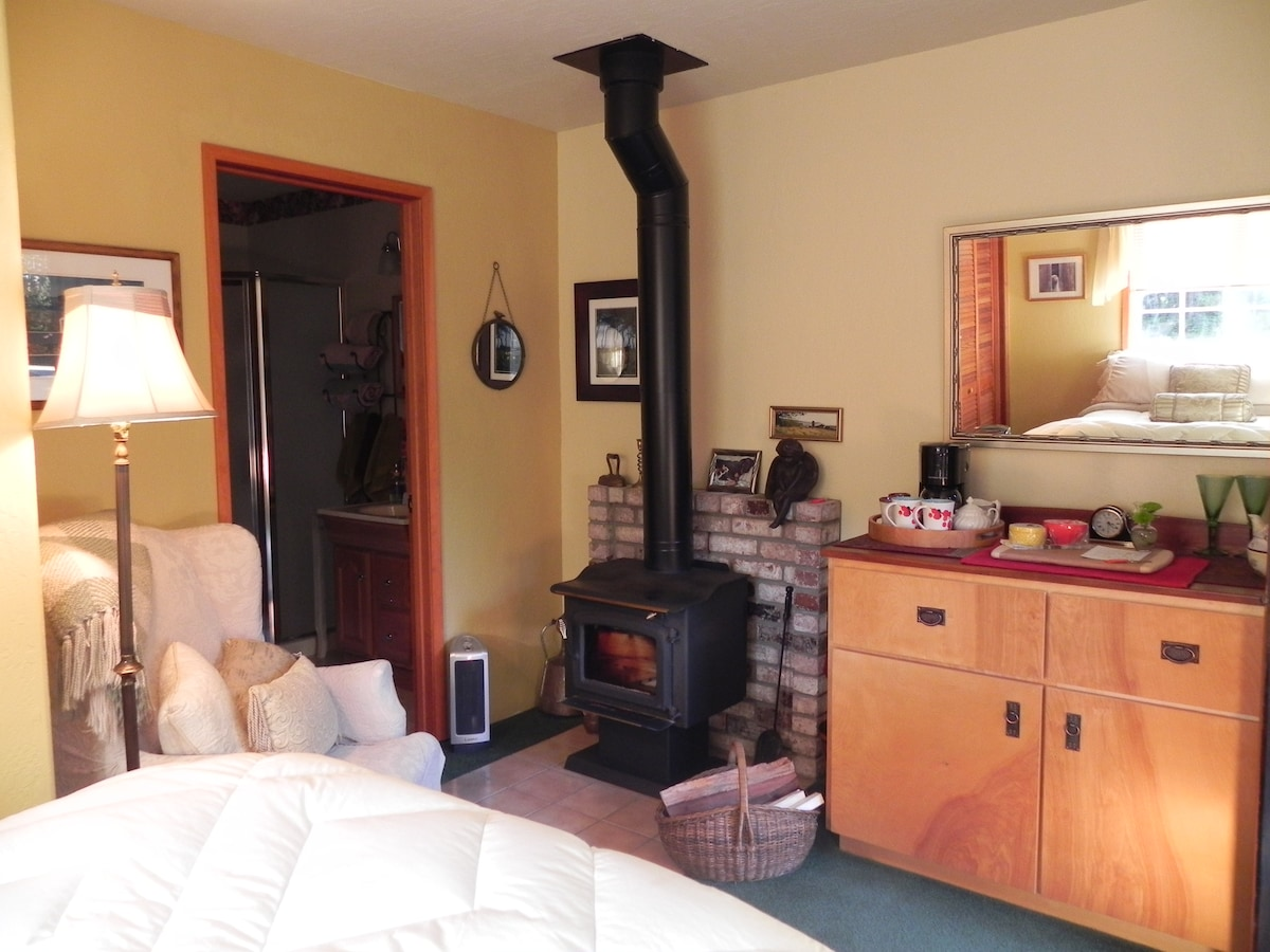 Cabinet with coffee maker, micro, refrig. Enjoy the coffee cake in front of the fire!
