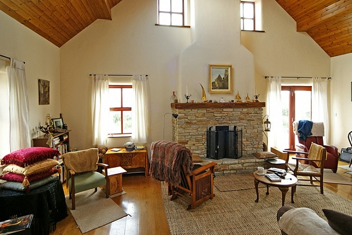 Living room,  pull out sofa,  fire place , lots of light,vaulted ceiling, T.V. and stereo.