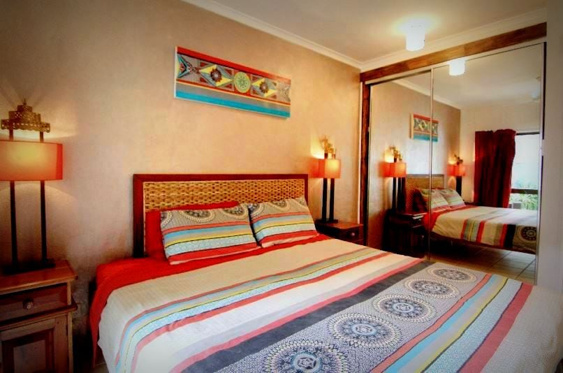 Room with king size bed.- en suite bath and courtyard area.   Also fridge, kettle, toaster and microwave.