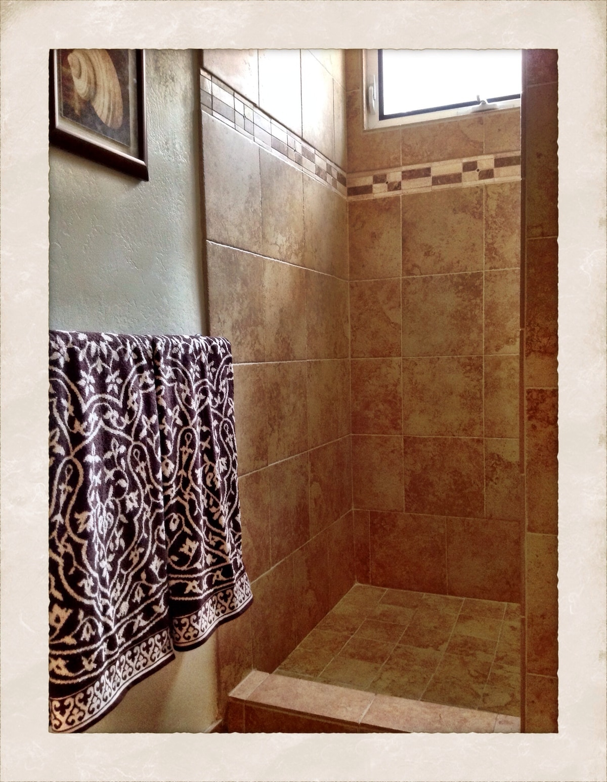 This is the beautifully tiled walk in shower.