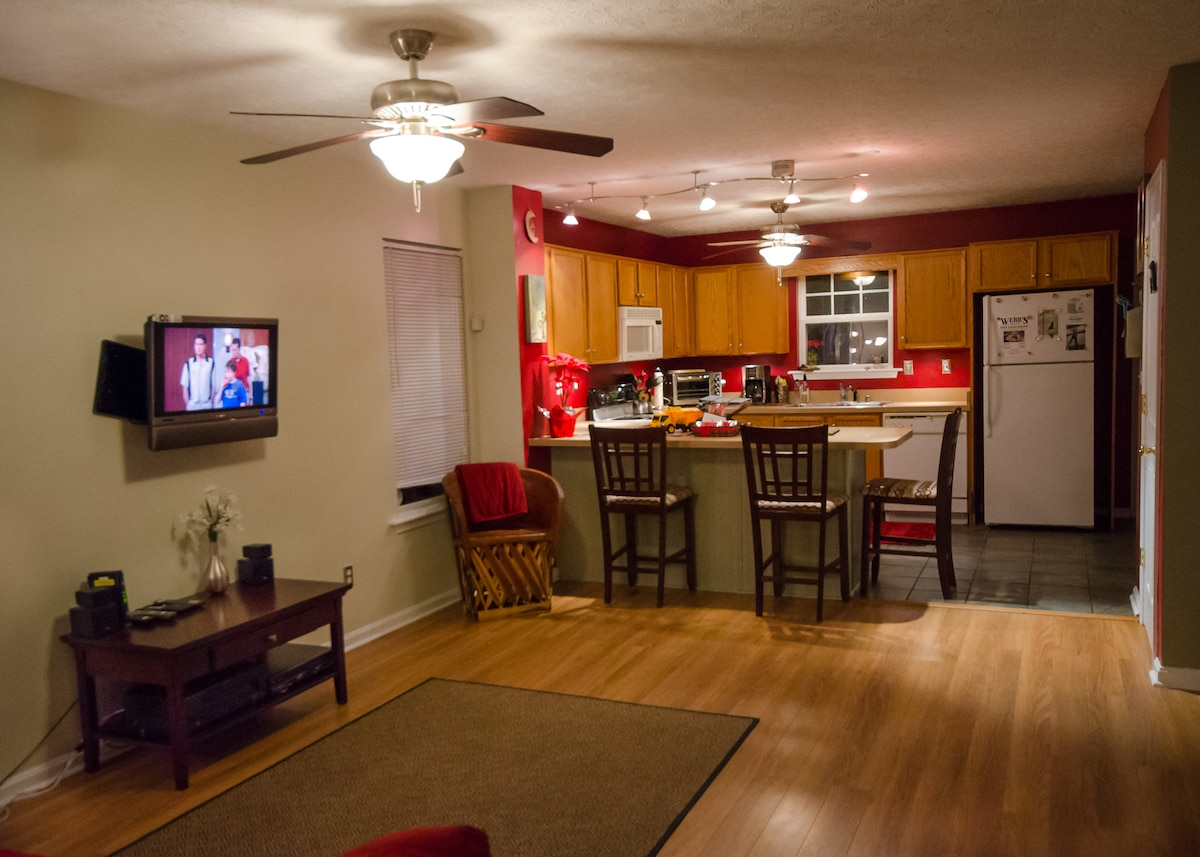 The open living room, & kitchen provides  plenty of room for entertaining or just relaxing for the evening.