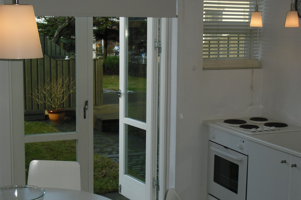 A nice fully equipped kitchen area with a great access to a big garden with patios and a hot tub.