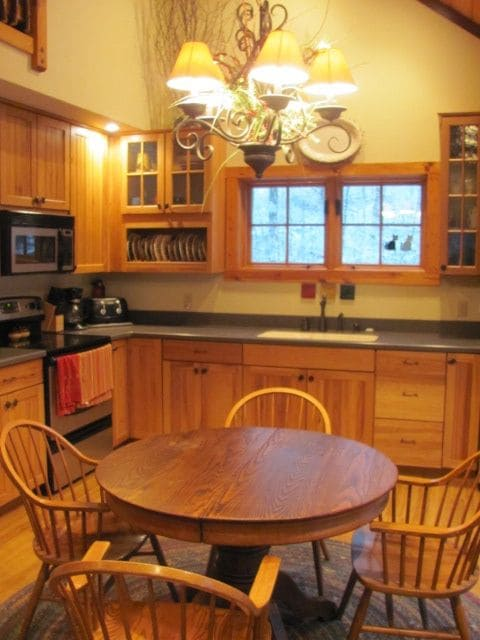 Preparing a home cooked meal together is easy in the well equipped kitchen.