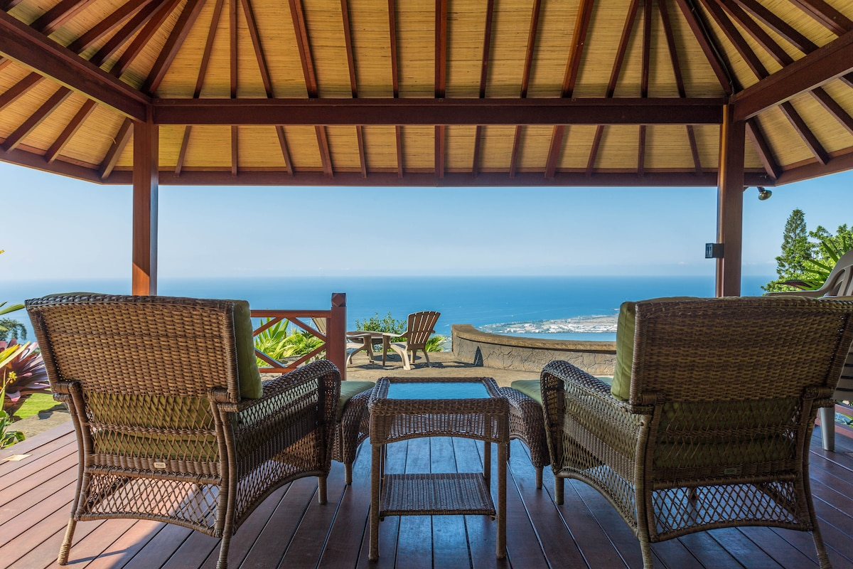Pavillion overlooks infinity edged hot tub and view of ocean and downtown Kona.