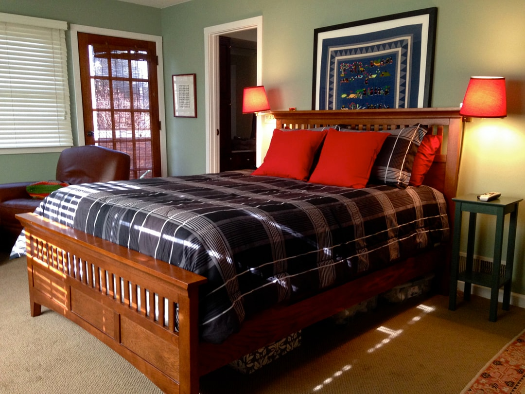 Bedroom #1--with queen sized bed, television, en suite bath and private deck.