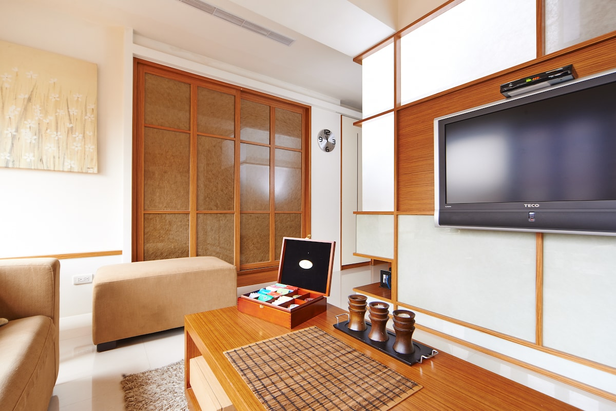 Living room with HD TV.  Free tea and coffee included