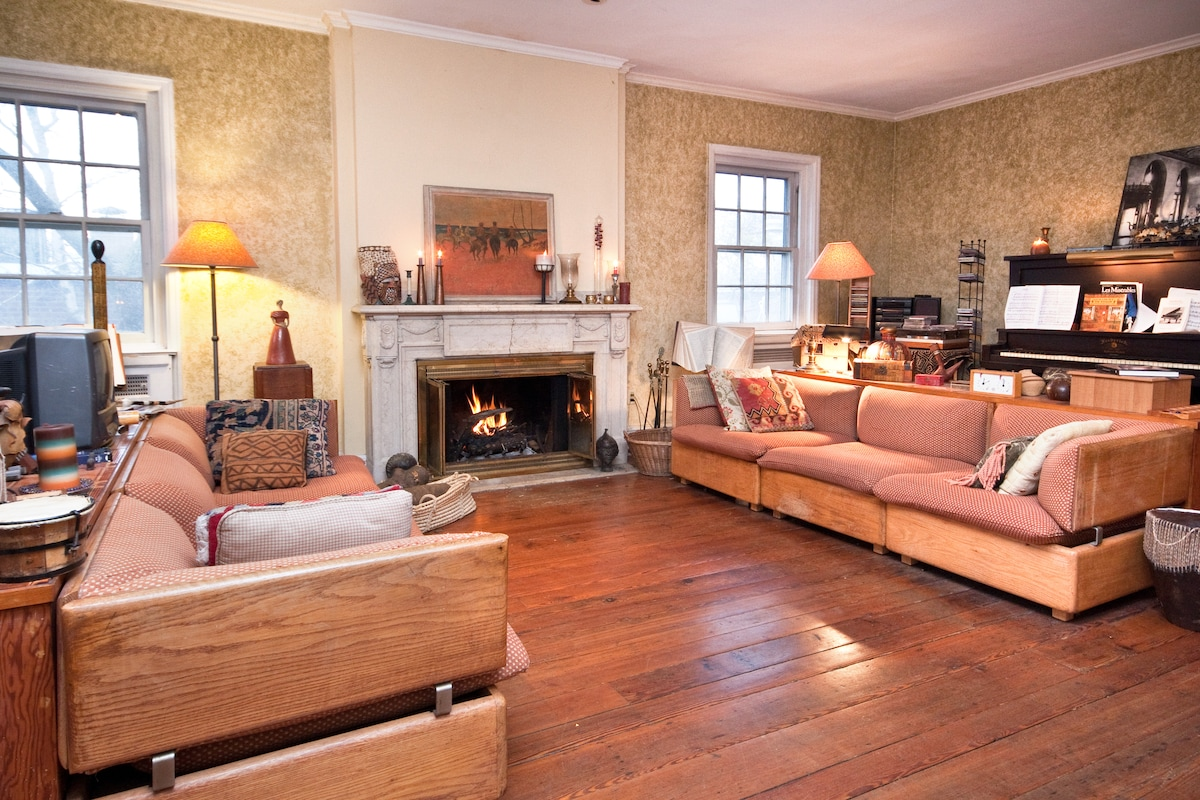 That's a piano at right, a working carved marble fireplace in the middle.  And historic reclaimed floors too.