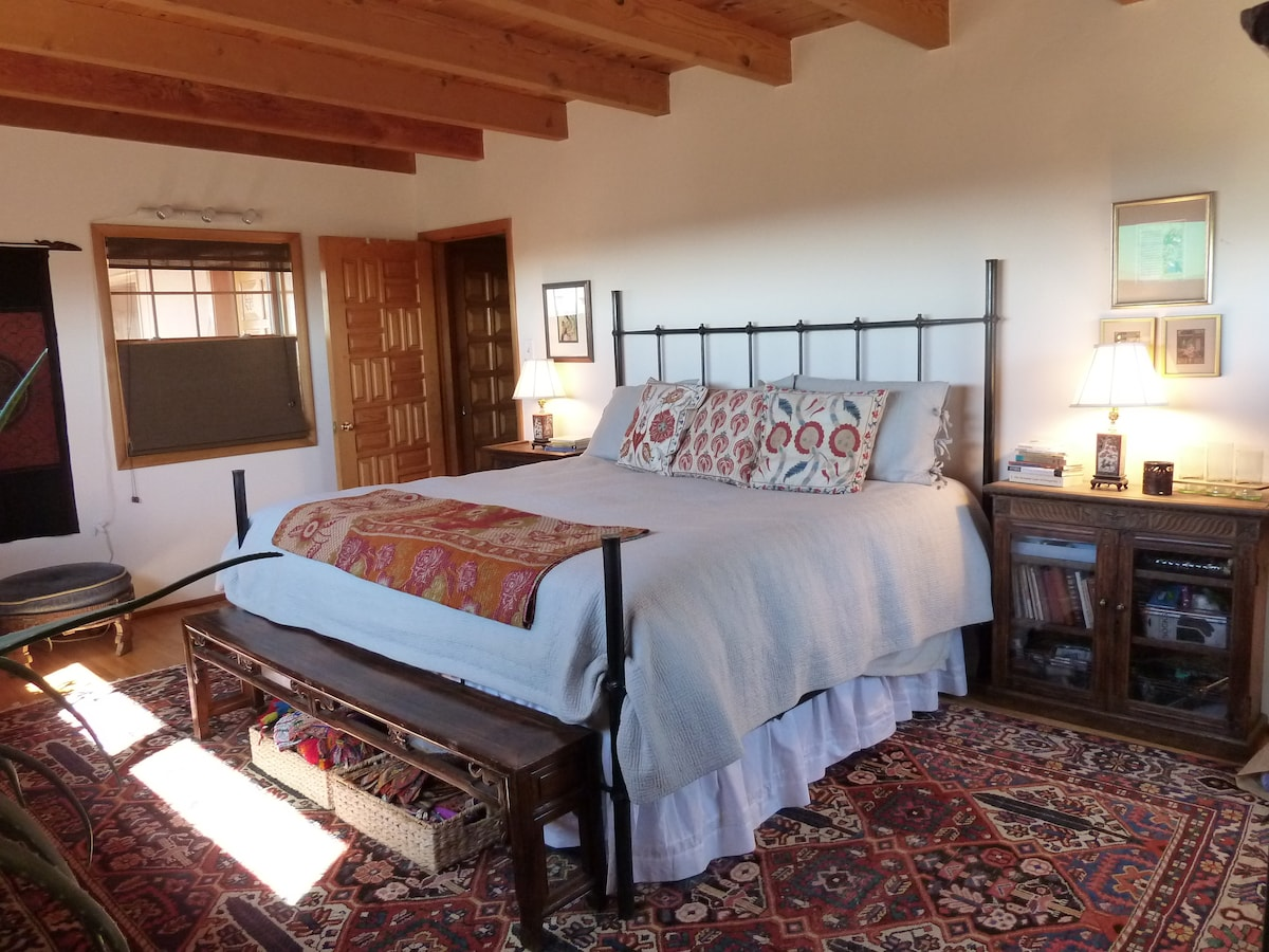 Master bedroom with king bed, private dressing area and bath with tub/shower.
