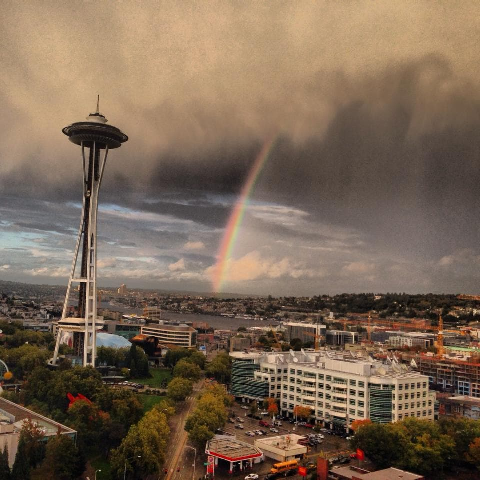 From the bedroom window - rainbow over Lake Union framed by the Space Needle.