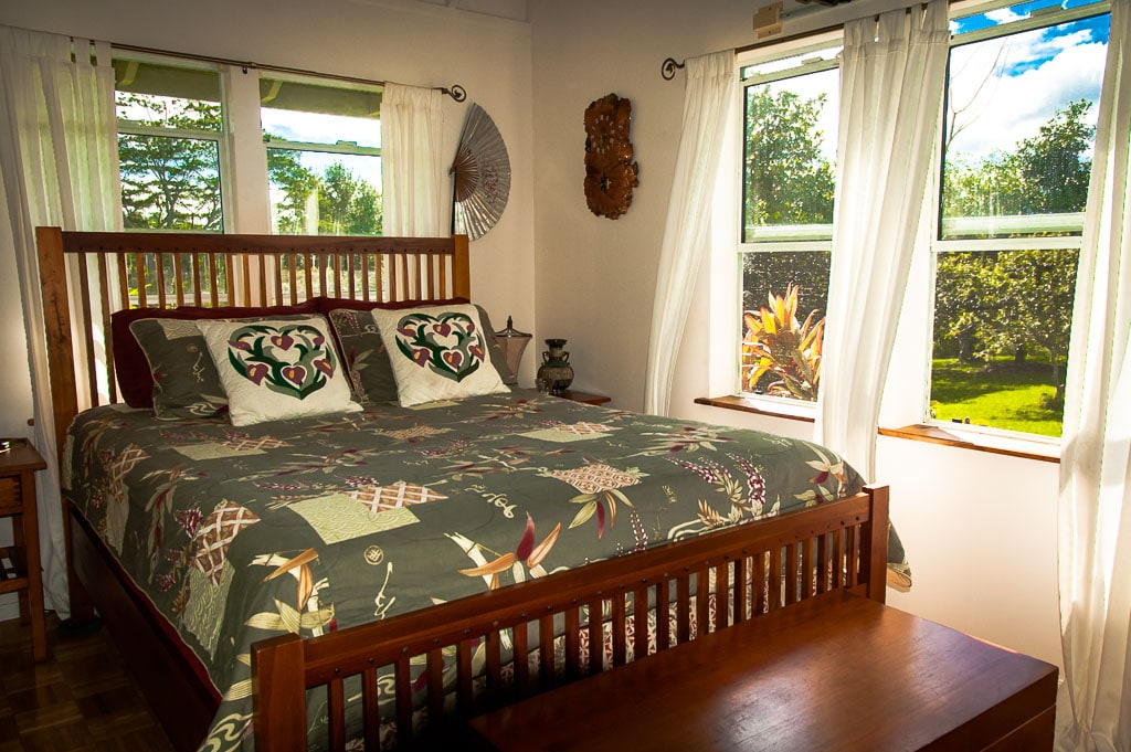 Comfortable queen size bed with view of the valley.
