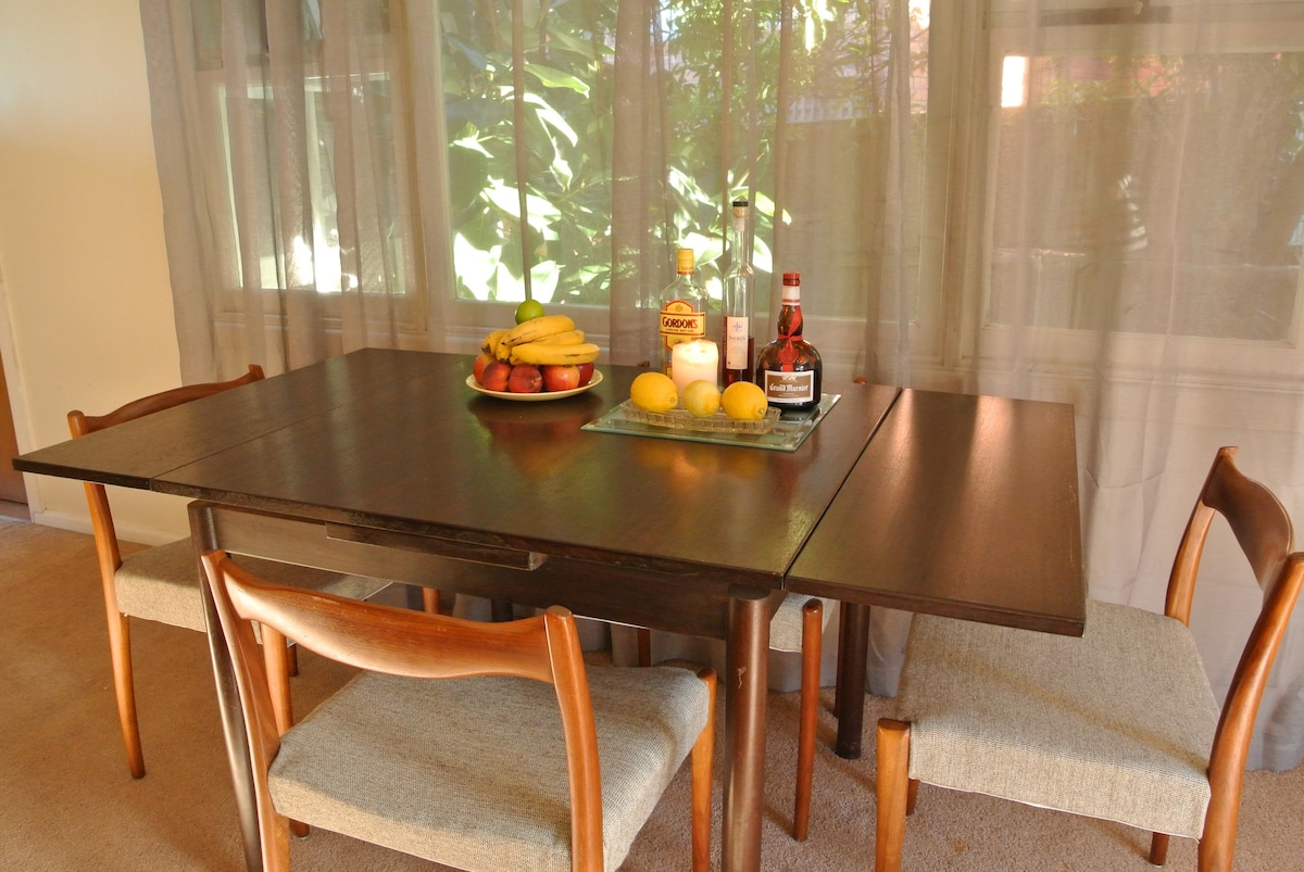 Dining table seats 6 to 8 people. Additional dining chairs are provided.