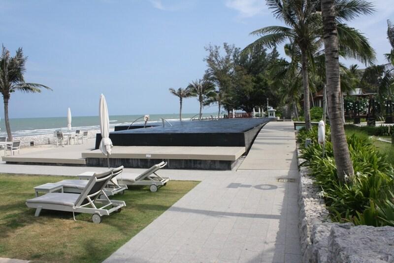"The beach and infinity pool of the ""Boathouse Hua Hin"" resort."