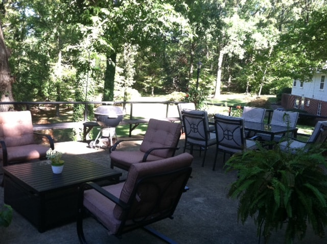 large deck overlooking 2 acre wooded lot in town.  Great place to unwind or have coffee in the morning
