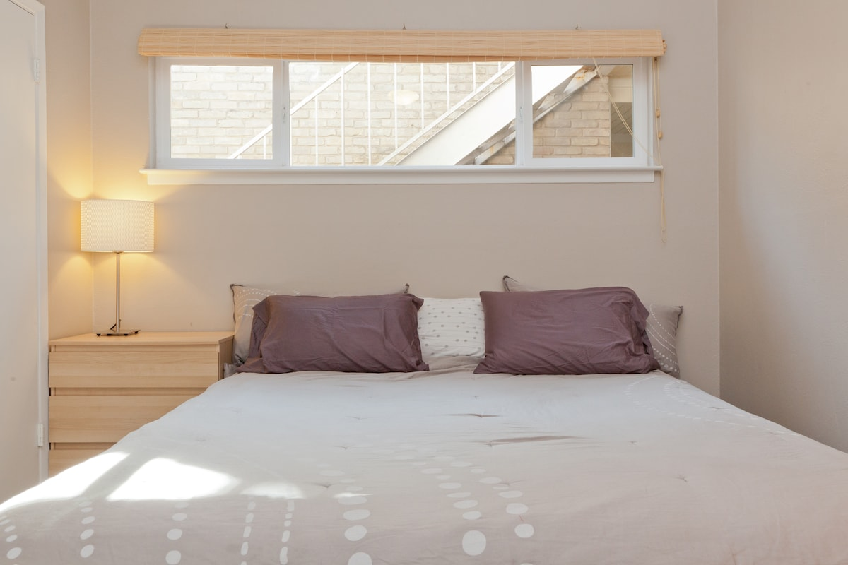 Private Master Suite, California King bed, there is tons of natural  light