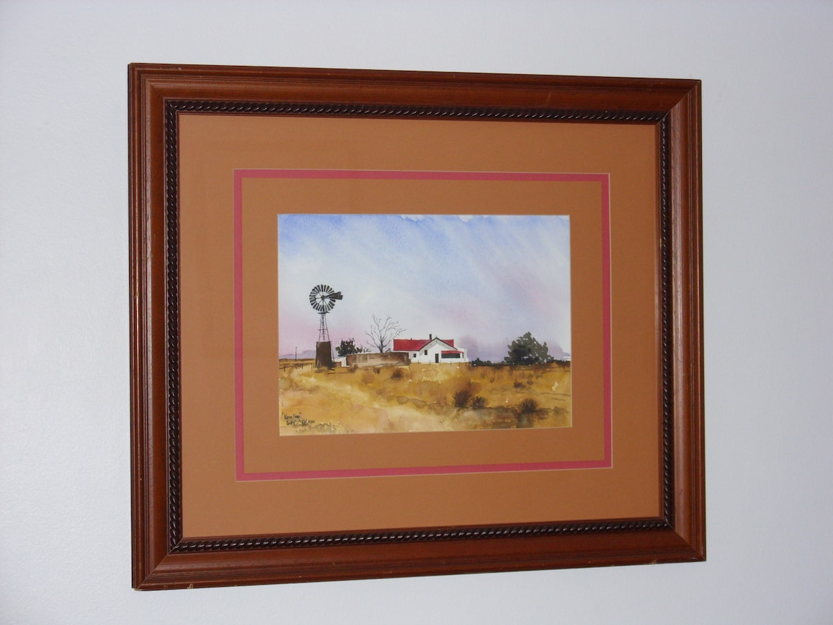 The painting you will look at while in the double bed....a Karoo farm