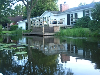 View from kayak on lake side of house.