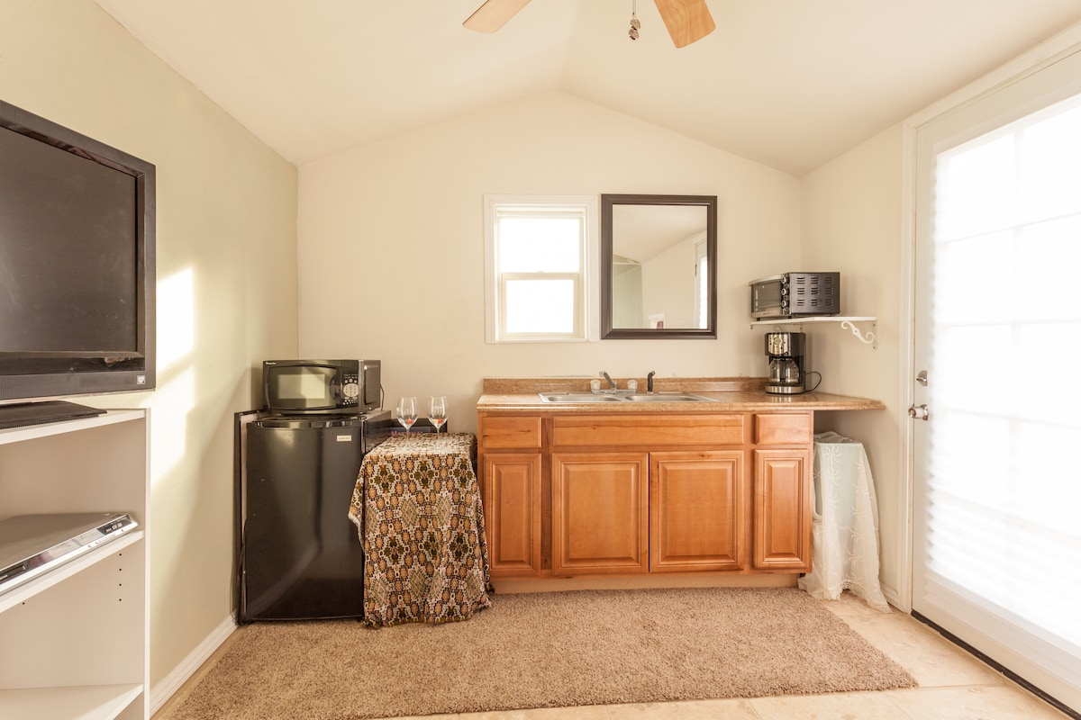 The cozy kitchenette with a sink, 2-burner hot plate, microwave, toaster oven, coffee pot & small fridge