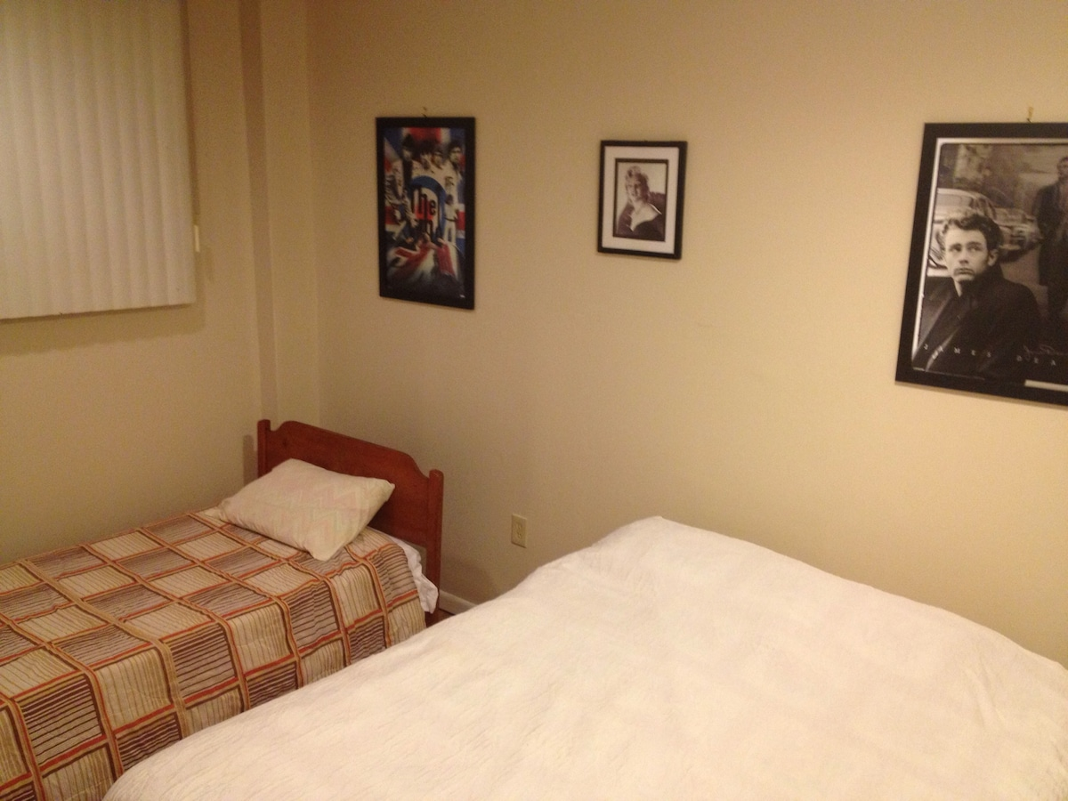 A second room with a queen bed with a twin bed.
