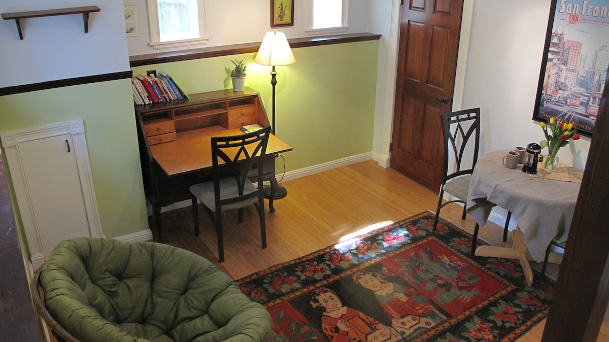 Living Room with Writer's Desk and Dining Table