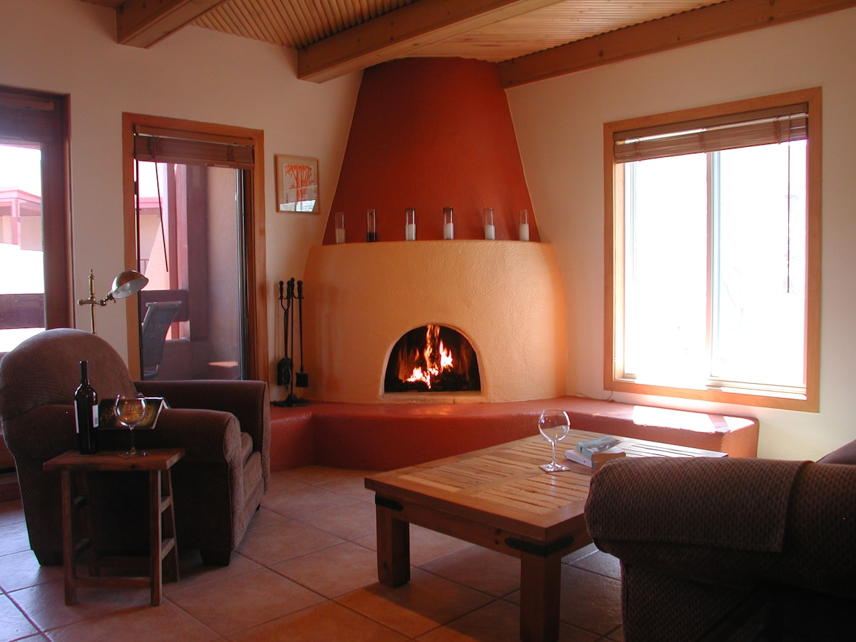Have a seat by the kiva fireplace and watch the magnificent mountain views