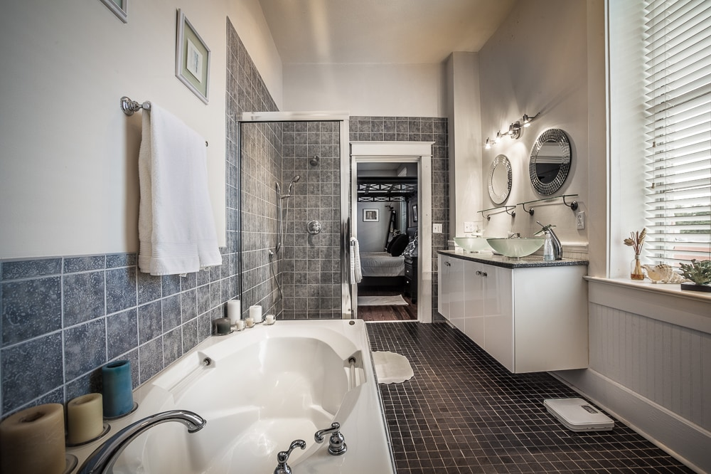 Master bath with garden tub, seperate glass shower and double vanity sinks