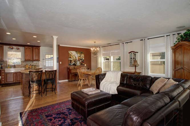 Fully equipped kitchen with over sized island, dishwasher, trash compactor, microwave oven, and gas stove. Kitchen overlooks back yard.