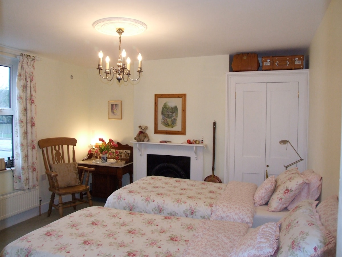 This family room can be arranged as two separate single beds, or as a super king-size  bed, as you desire.