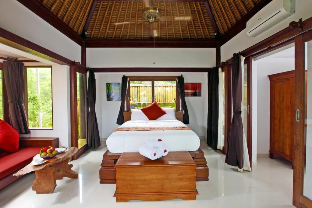 The interior of Villa Ananda. There is an ensuite outdoor bathroom on the right.