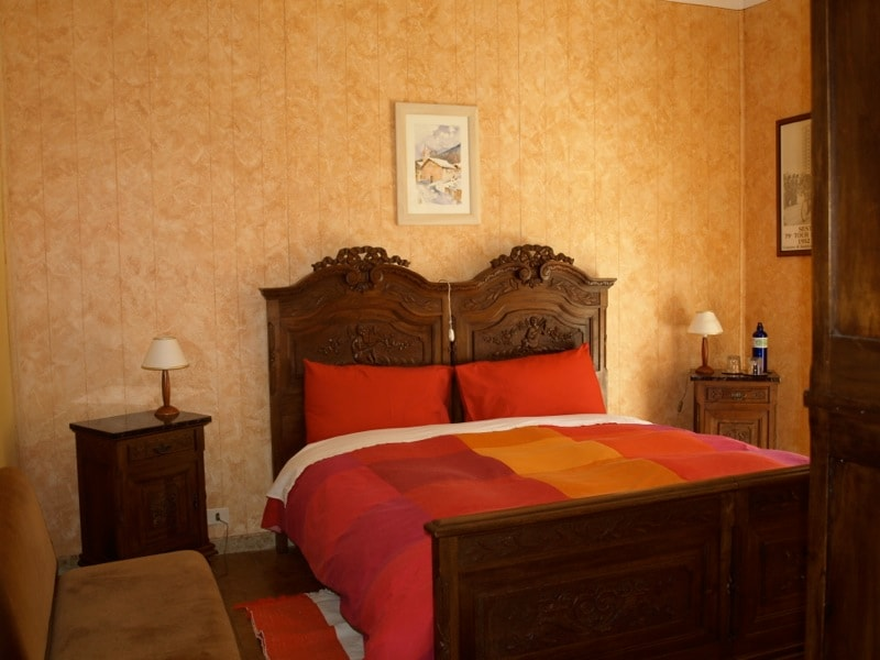 Fabrizio restored his grandfathers cherry bedroom set for this room.
