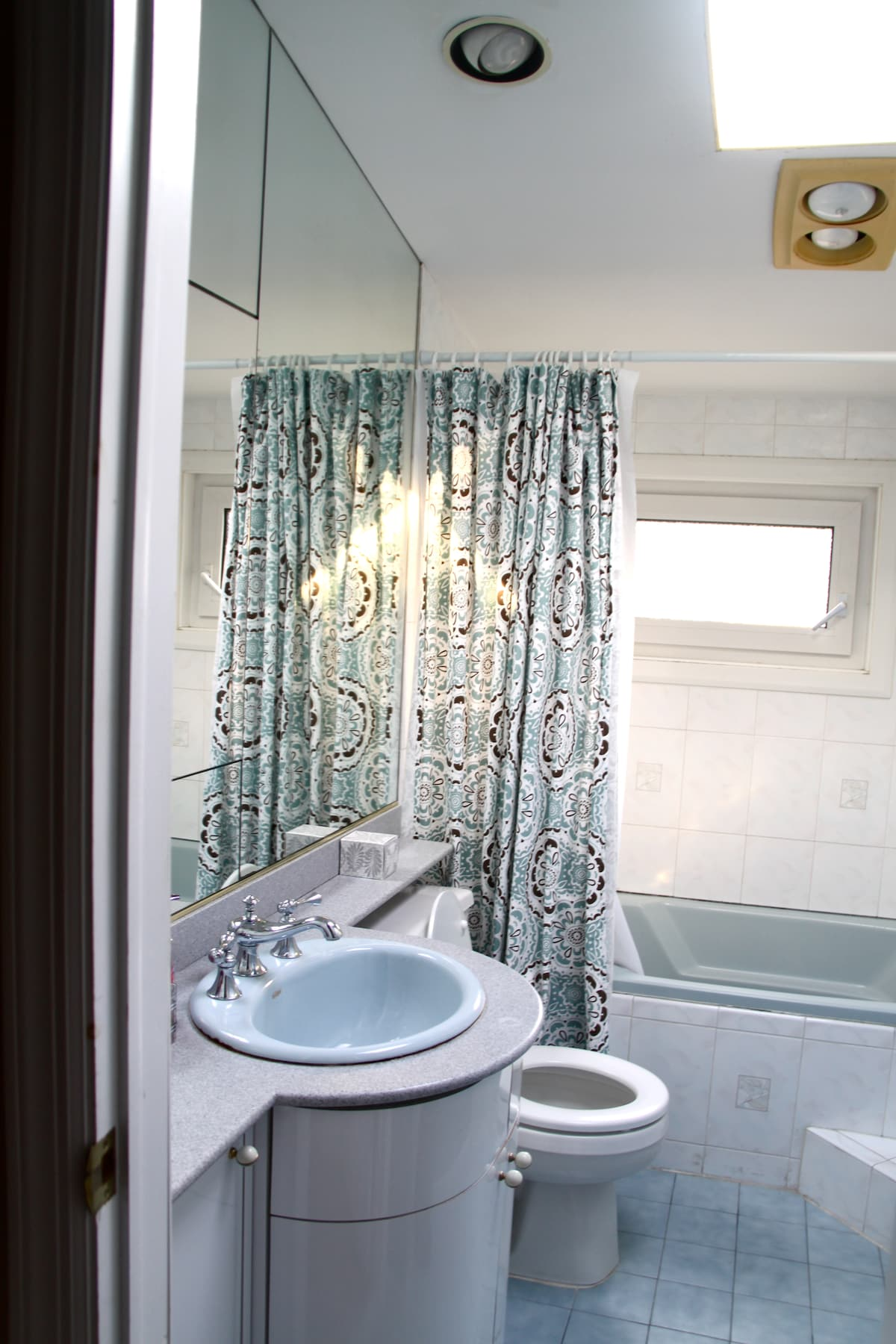 A well-lit bathroom with sky-lights and heat-lamps is right down the hall from your room.