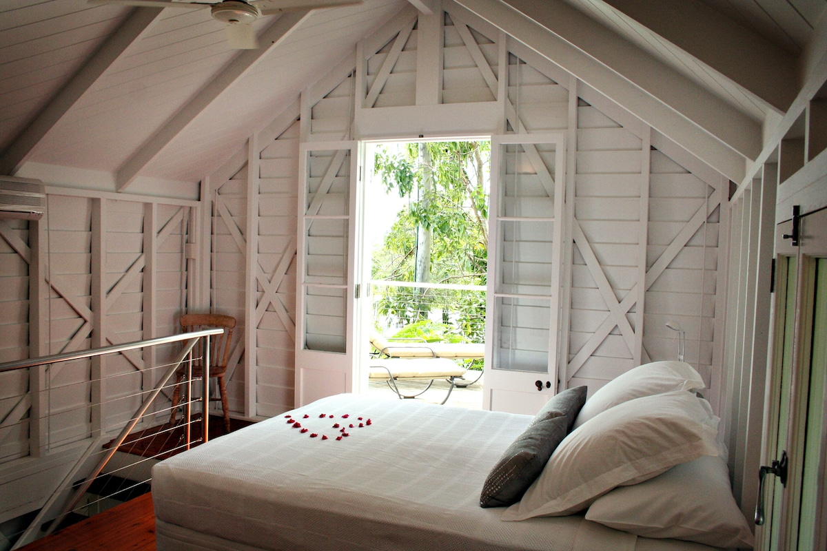 Romantic loft bedroom with Queen size bed, spacious deck with mountain views.