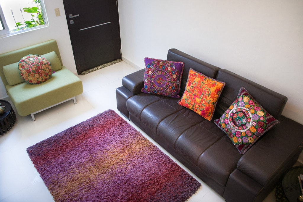 confortable sofa and sofa bed, with mexican decorative pillows