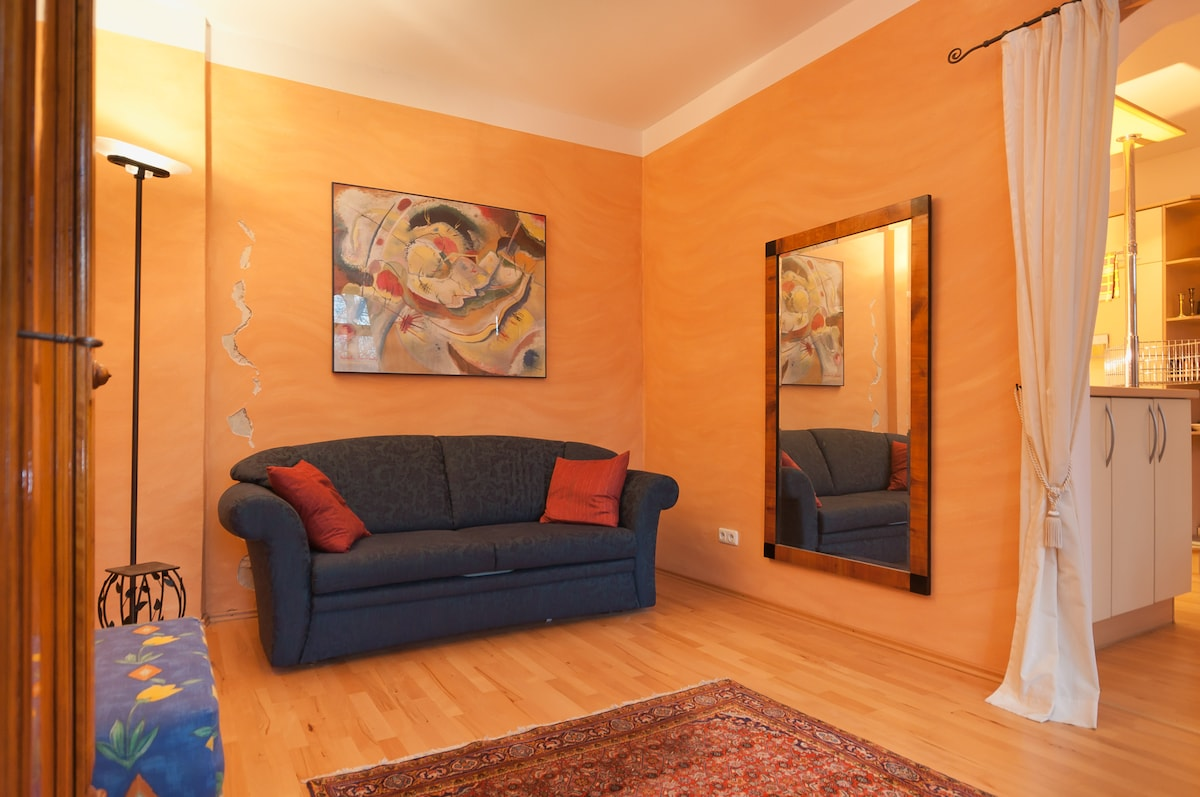 Living room/Sofa-bed 140cm wide The crack in the wall is  ART!