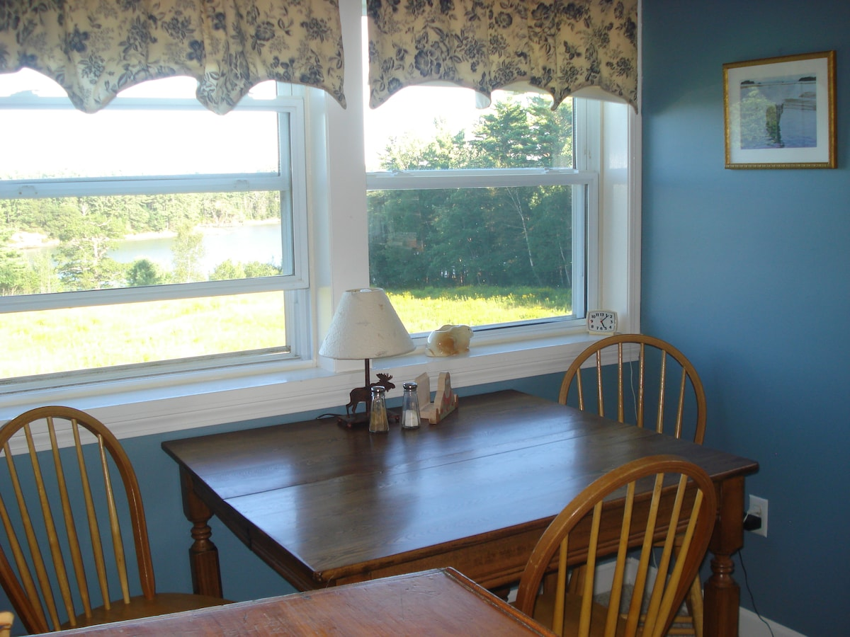 Look out over the fields and water while enjoying breakfast