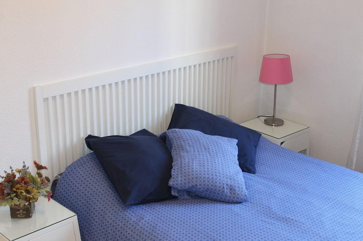 Bright spacious room with big sized double bed.