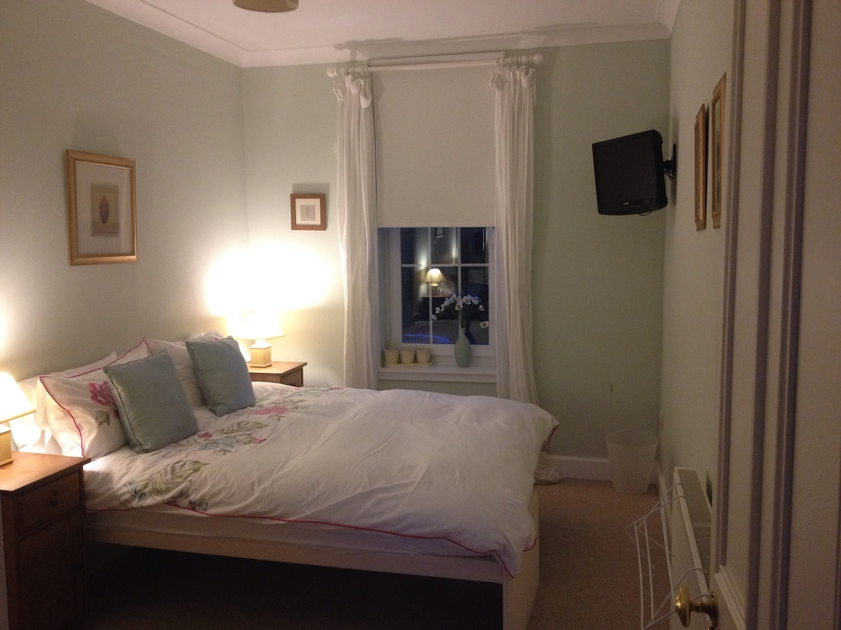 Comfortable Double bed with Feather mattress and pillows. Newly installed TV/DVD.