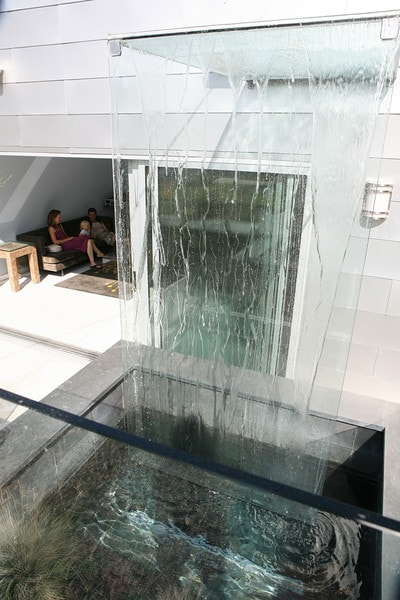The water feature is on the patio, with sliding glass doors to the living area