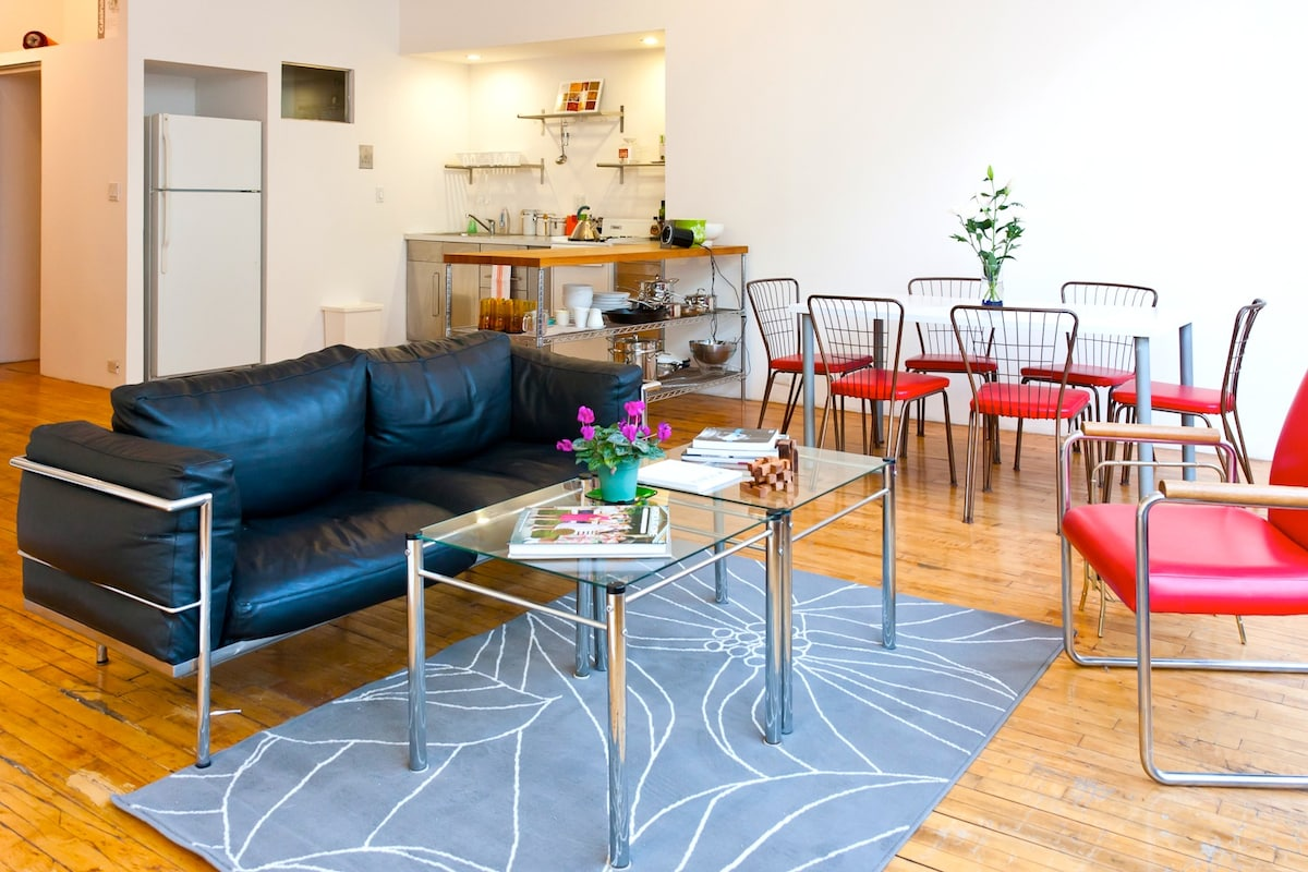 Plan your next outing from the living room. Your host obviously has a passion for mid-century furniture design.