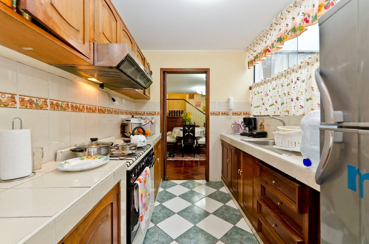Illuminated kitchen have electric appliances and all accessories to make your own meal.