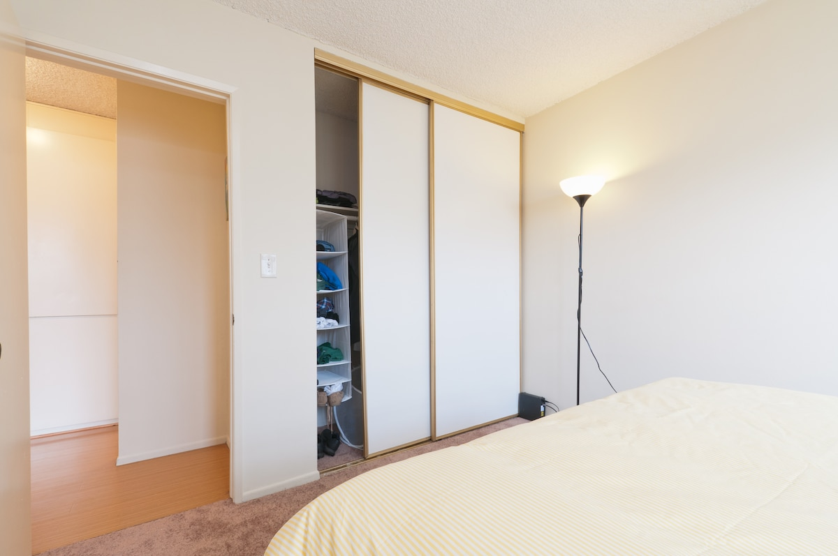 Large closet with many wooden hangers