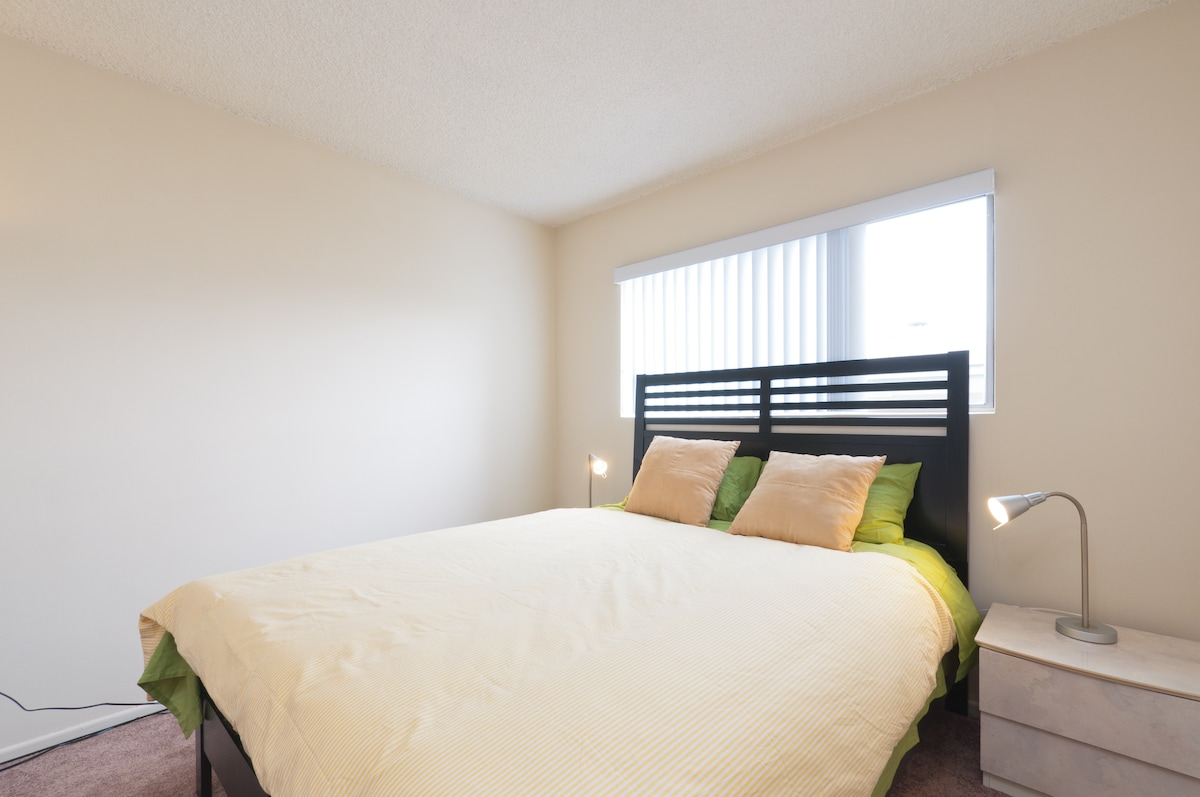 Sunny bedroom with very comfortable queen size bed.
