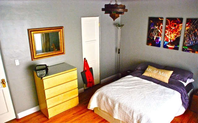bedroom with mounted 42' flat screen, beach bags provided for your convenience