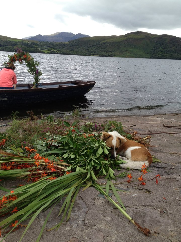 Decorating complementary boat with wild flowers grown in garden for wedding pics!!