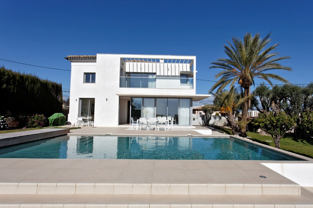 The main house with pool, sun deck and lovely sea view
