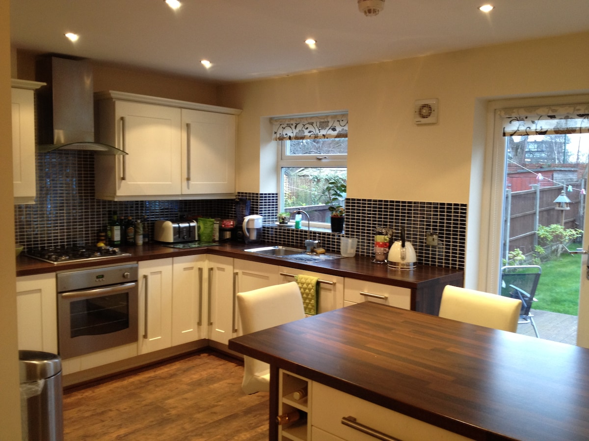 Bright kitchen with patio doors to garden