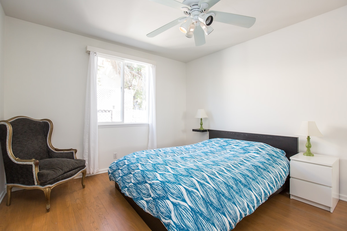 Bedroom with queen size bed with memory foam topper.