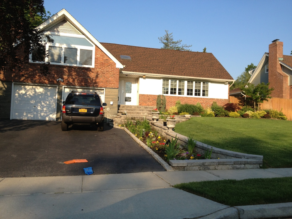 This is the front of the house. My husband has TWO green thumbs and maintains the gardens with beautiful flowers!